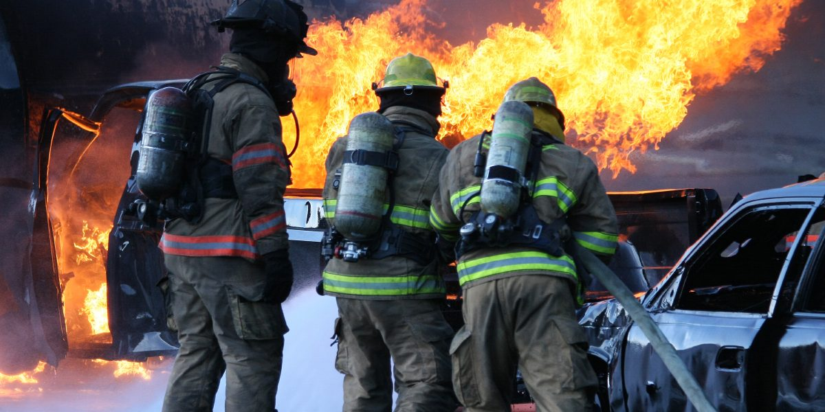 Firefighters putting out a diesel fire at a Firefighter Training camp. (copyspace)